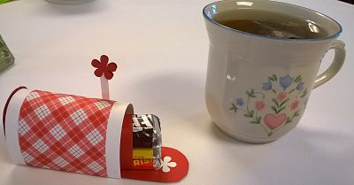 ladies tea tea cup and mailbox